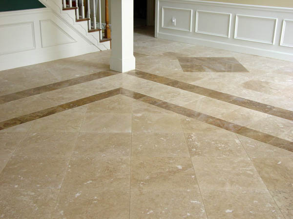 18x18 Travertine Tiles With Darker Border And Diamond Accents In The Foyer