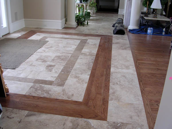 Two shade travertine tiles with border combined with Hardwood and tile floor designs